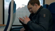 Young people entertaining with pad in the train video