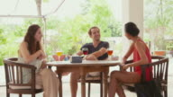 Young people, friends relaxing in hotel bar, resort restaurant, lifestyle video