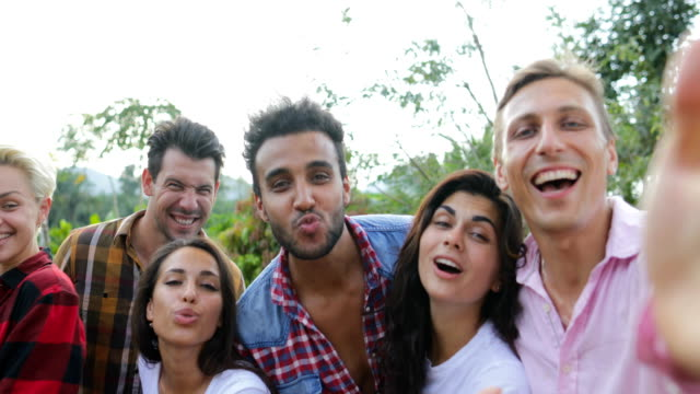 Young People Happy Smiling Take Selfie Photo Friends Mix Race Group Closeup Posing Outdoors video