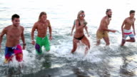Young people have fun at the beach video