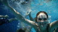 Young people having fun under water in pool video