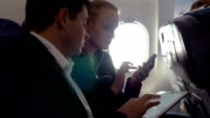 Young people making agreement in the plane video