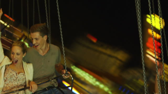 Young people on Chairoplane video