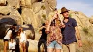 Young people on road trip look through binoculars video