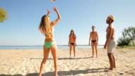 Young people play volleyball. video