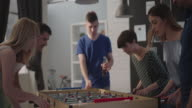 Young People Playing Foosball. video