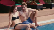 Young people relaxing in hotel swimming pool, gym, bar, holidays video