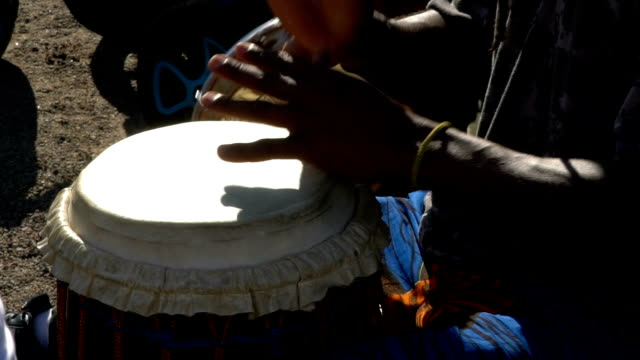 Young people sing and play drums in a City Park.  Slow Motion video
