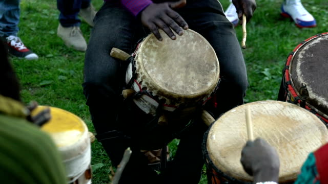 Young people sing and play drums in a City Park. video