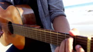 Young person on road trip playing guitar video