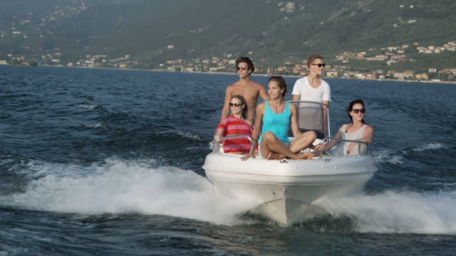 Young poeple on motor boat video