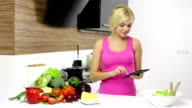 young pretty girl looking recipe prepare dinner video