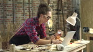Young Pretty Hipster Buys Online Right from her Workshop video