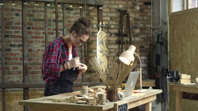 Young Pretty Hipster Paints her Rustic Wooden Toys video