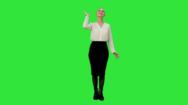 Young pretty woman throw papers finishing work successfully on a Green Screen, Chroma Key video