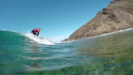 SLOW MOTION UNDERWATER: Young pro surfer surfing on big wave video
