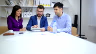 Young Professionals Discussing Ideas at a Meeting video