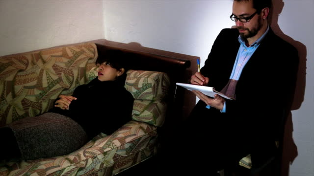 Young psychologist in therapy for a depressed woman video