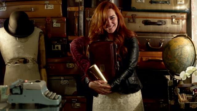 Young red hair storekeeper standing in handbag retail video HD video