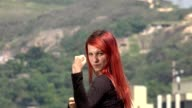 Young Redheaded Woman Practicing Martial Arts video
