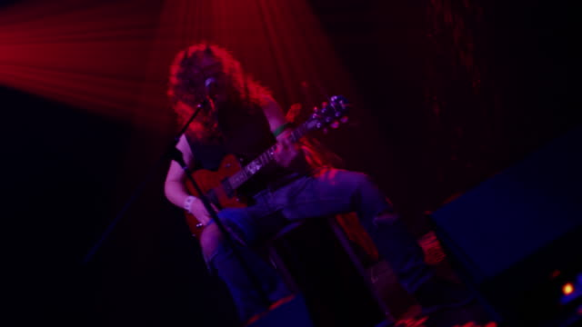 LS Young rocker playing guitar and singing on the stage video