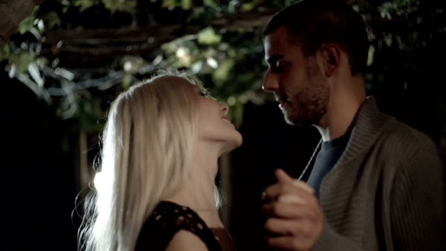 Young romantic man-woman couple in love dances outdoor at night - slow-motion HD video footage video