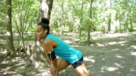 Young runner stretching and warming up during outdoor workout video