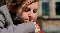 Young sad woman standing outdoors alone, feeling emotional stress video