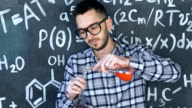 Young scientist man make laboratory experiment in chemical and mathematical equations wall room video