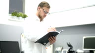 Young scientist working in laboratory. Male researcher. video