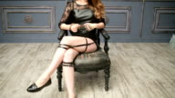 young sexy brunette girl in leather garters video