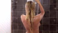 young sexy woman having a shower video