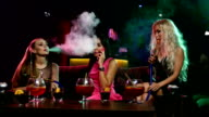 Young sexy womans smoking the hookah in vintage interior video
