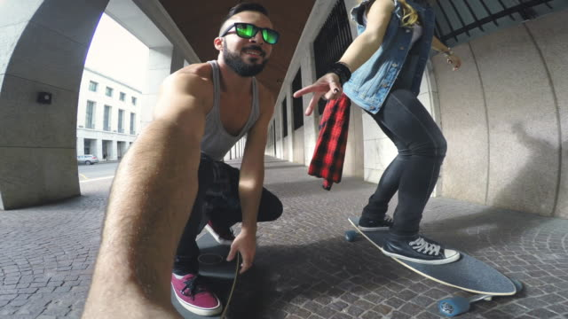 Young skater take a selfie video while riding video