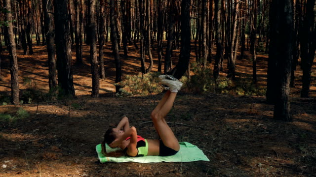 young slender sexy girl lies on her back and shakes press video