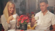 Young Smiling Couple in Outdoor Coffee Shop video