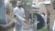 HD: Young Smiling People Barbecue In Backyard. video