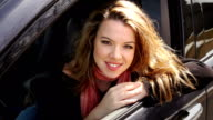 Young smiling woman in the car video