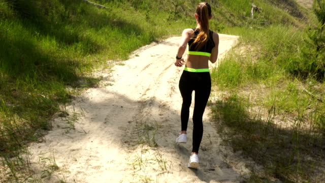 young sports girl in uniform running video