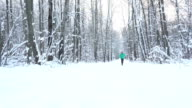 Young Sportsman Running Through Snowy Forest. Training and exercising outdoors when cross country running in inspirational winter landscape. Sports Motivation. video