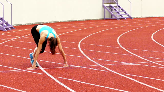 Young Sportswoman training on running track Slow Motion Video video