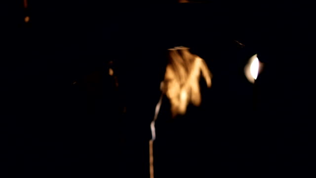 Young strong woman boxing in the dark. Slow motion. video