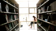 Young student sitting and studying in the library video