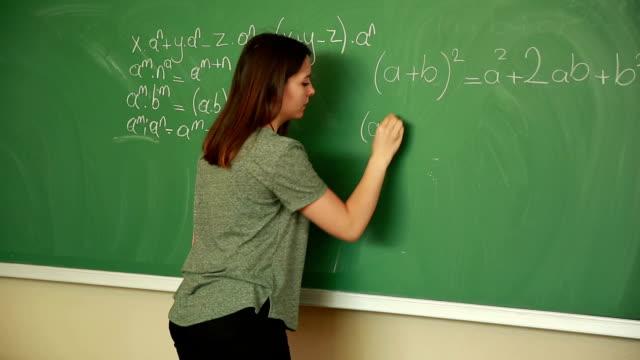 Young student writing math formula video