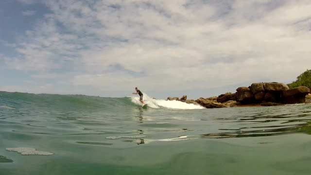 CLOSE UP: Young surfer riding waves video