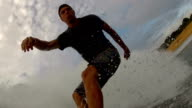 CLOSE UP: Young surfer surfing big wave video