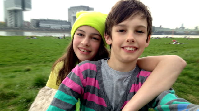Young Teenage Boy and Girl, Brother and Sister, taking Selfies video