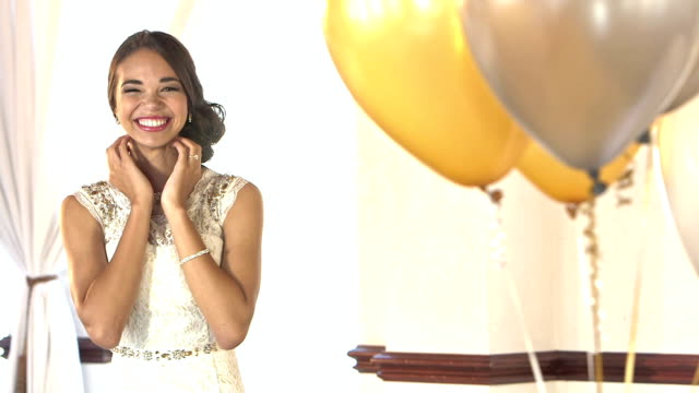 Young teenage girl in prom dress, nervous excitement video