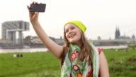 Young Teenage Girl taking Selfies outdoors, sassy smile video