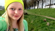 Young Teenage Girl taking selfies outdoors, sassy, stick out tongue video